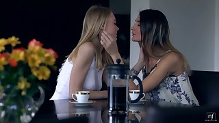 Two beautiful girls are making honour increased by kissing up scissor position