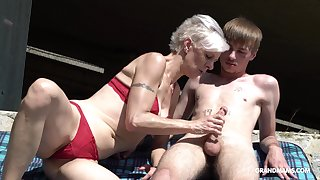 Kinky granny in thongs sucks a big hard penis be expeditious for one young guy
